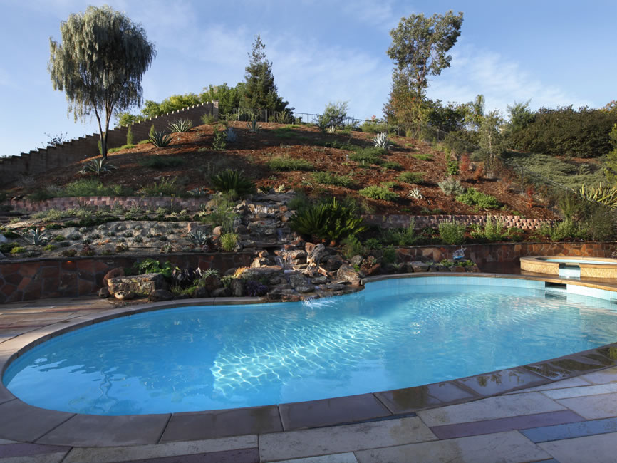Orange county pool cleaning maintenance orange county spa for Pool design for sloped yard