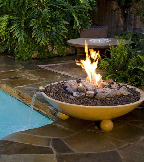 Floating lights fire bowls and variable speed pumps - Pool fire bowls ...